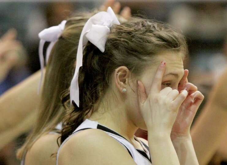 3/2/2012: A Kingwood Park cheerleader can't stand to watch Kingwood throw free throws late in the ga