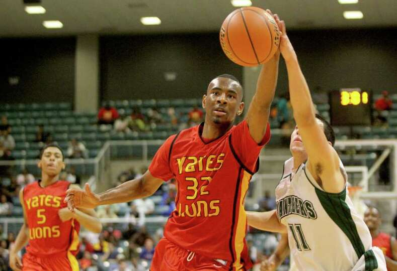 3/2/2012: Clyde Santee #32 of Yates fights for a loose ball over Hunter Pounds #11 of Kingwood Park