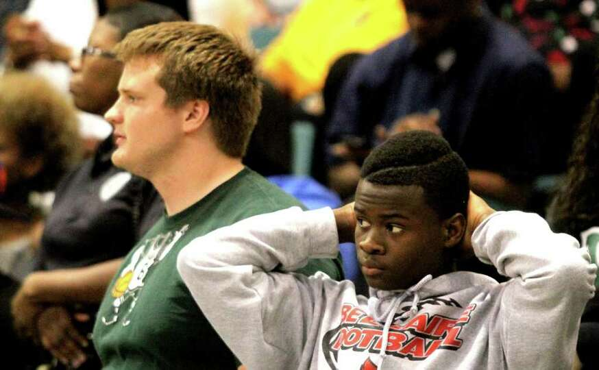 3/2/2012: Kingwood Park fans stand dejected as Yates defeated Kingwood in the 4A regional semifinals