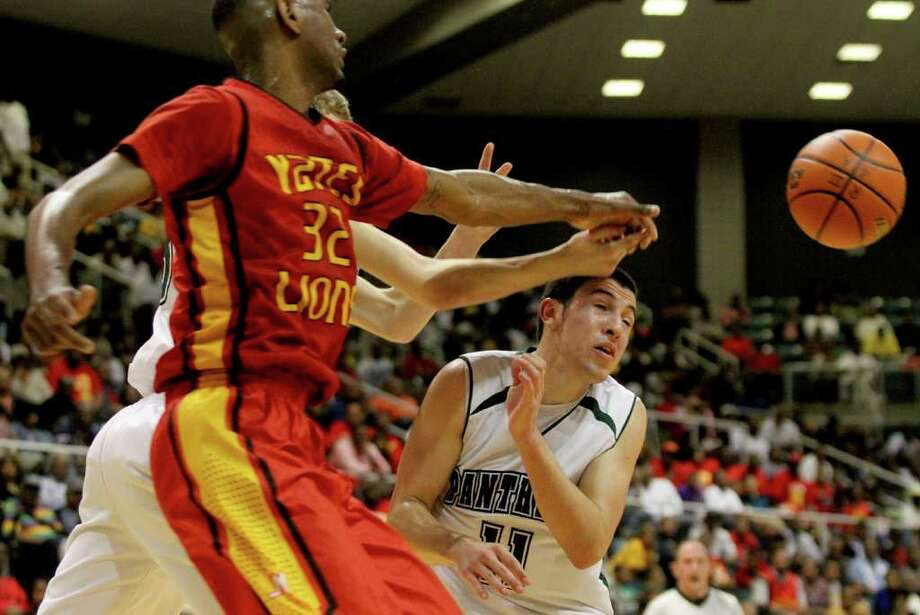 3/2/2012: Clyde Santee #32 of Yates knocks the ball away from Hunter Pounds #11 of Kingwood Park in the 4A regional semifinals high school mens basketball game at the Merrell Center in Katy, Texas. Photo: Thomas B. Shea, For The Chronicle / © 2012 Thomas B. Shea