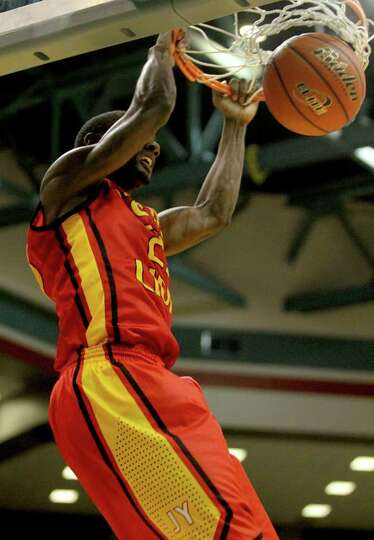 3/2/2012: Damion Dotson #21 of Yates dunks on Kingwood Park in the 4A regional semifinals high schoo
