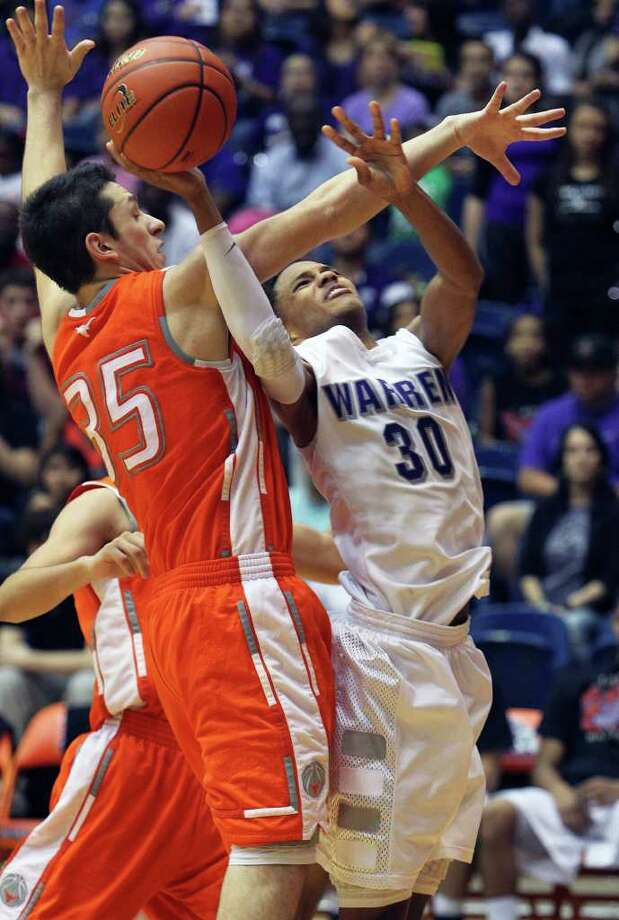 The Warrior's Jerell Ellis gets fouled by Eddie Vasquez as Warren beats Laredo United 83-50 in the first round of the Region IV 5A basketball tournament at the UTSA Convocation Center on March 2, 2012 Tom Reel/ San Antonio Express-News Photo: TOM REEL, Express-News / San Antonio Express-News