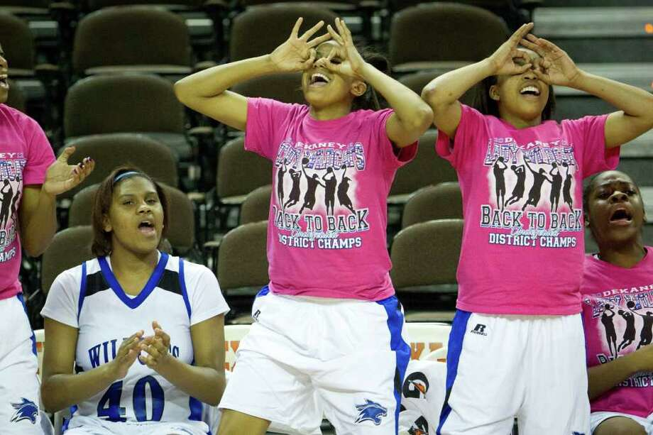 Players on the Spring Dekaney bench celebrate a three-pointer by forward Shunta Nevitt during second half action in a class 5A semifinal game against San Antonio Reagan during the UIL girls state basketball tournament at the Frank Erwin Center on Friday, March 2, 2012, in Austin. Dekaney won the game 50-35. Photo: Smiley N. Pool, Houston Chronicle / © 2012  Houston Chronicle