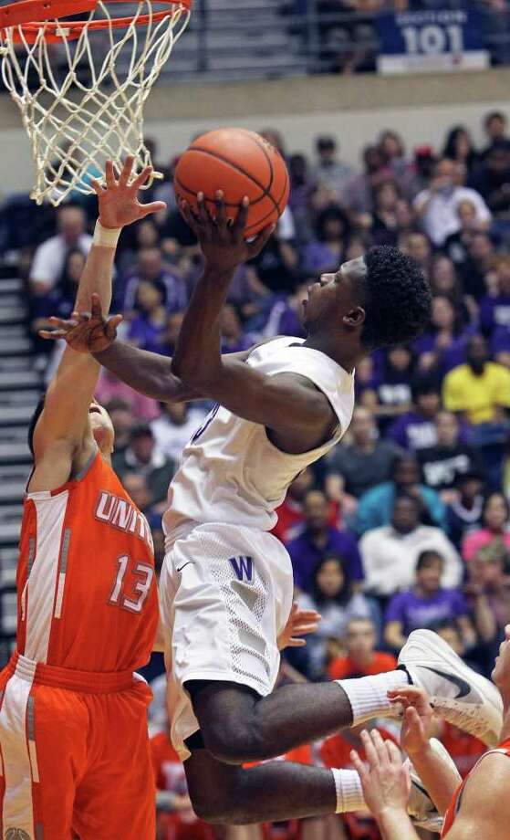 Warrior guard Demarcus Garcia floats in for a shot against Thomas Johnson as Warren beats Laredo United 83-50 in the first round of the Region IV 5A basketball tournament at the UTSA Convocation Center on March 2, 2012 Tom Reel/ San Antonio Express-News Photo: TOM REEL, Express-News / San Antonio Express-News