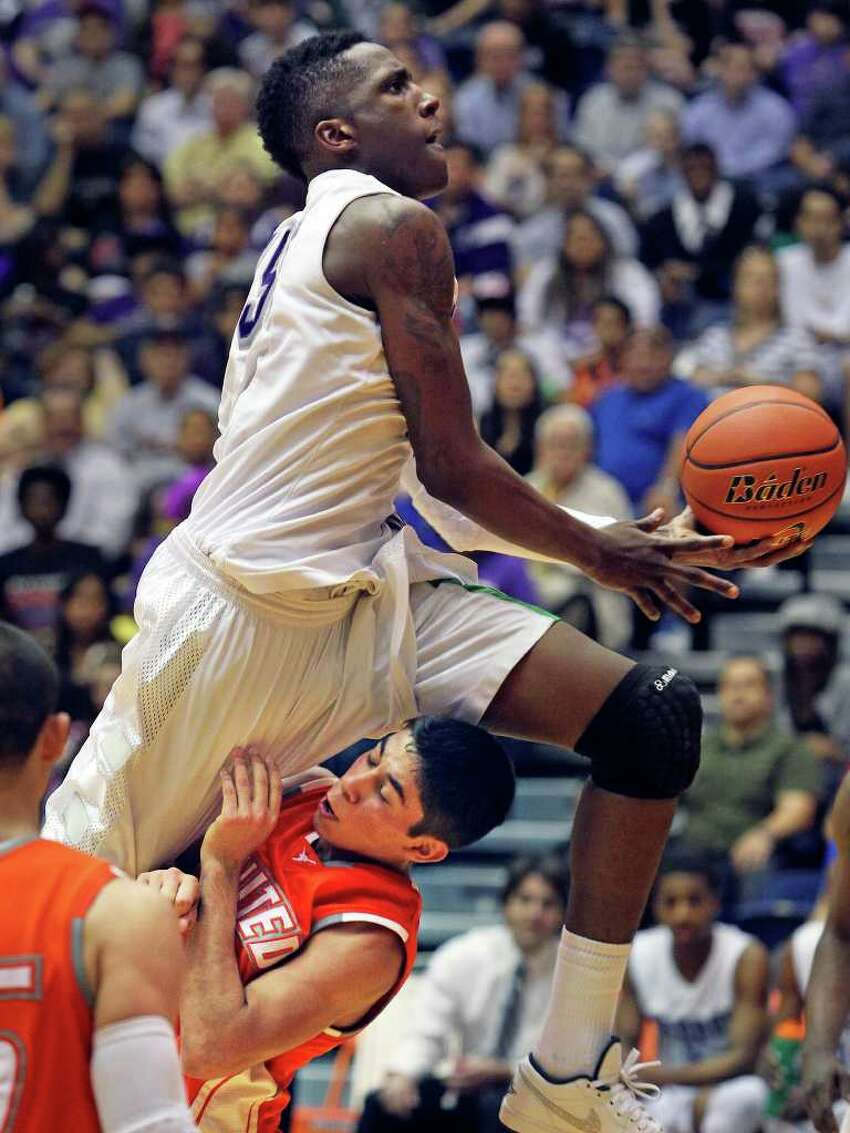 Taurean Waller Prince gets tangled at the heels by Thomas Johnson on his way to the bucket in the second half as Warren beats Laredo United 83-50 in the first round of the Region IV 5A basketball tournament at the UTSA Convocation Center on March 2, 2012 Tom Reel/ San Antonio Express-News