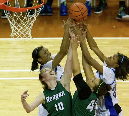 Spring Dekaney guard Brianna Taylor (20) and guard Jaleesa Chapel (25) fight for a rebound against San Antonio Reagan guard Wendy Knight (10) and center Corrigan Tibbs (45) during second half action in a class 5A semifinal game during the UIL girls state basketball tournament at the Frank Erwin Center on Friday, March 2, 2012, in Austin. Dekaney won the game 50-35. Photo: Smiley N. Pool, Houston Chronicle / © 2012  Houston Chronicle