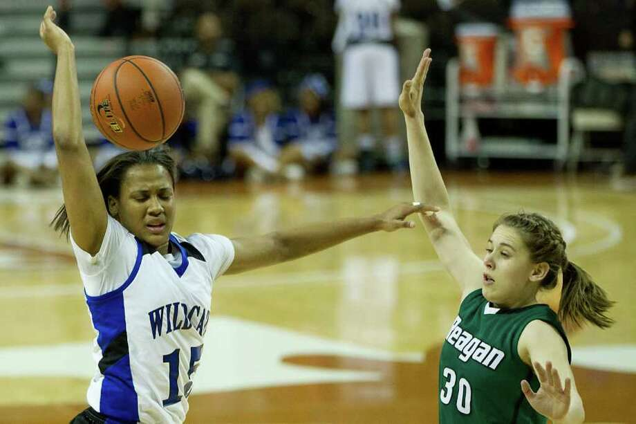 Spring Dekaney guard Alexis Durley (15) loses the ball as San Antonio Reagan guard/forward Malorie Dyer (30) defends during first half action in a class 5A semifinal game during the UIL girls state basketball tournament at the Frank Erwin Center on Friday, March 2, 2012, in Austin. Mansfield Summit won the game. Photo: Smiley N. Pool, Houston Chronicle / © 2012  Houston Chronicle