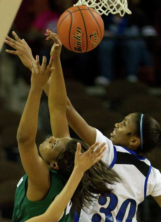San Antonio Reagan center Brandi Kendley  has the ball knocked away by Spring Dekaney forward Shunta Nevitt (30) during first half action in a class 5A semifinal game during the UIL girls state basketball tournament at the Frank Erwin Center on Friday, March 2, 2012, in Austin. Mansfield Summit won the game. Photo: Smiley N. Pool, Houston Chronicle / © 2012  Houston Chronicle