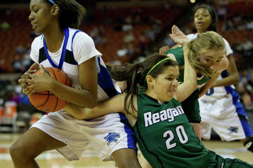 Spring Dekaney guard Kayla Nevitt (23) rips a rebound away from San Antonio Reagan guard Tessa Ramiriz (20) during first half action in a class 5A semifinal game during the UIL girls state basketball tournament at the Frank Erwin Center on Friday, March 2, 2012, in Austin.