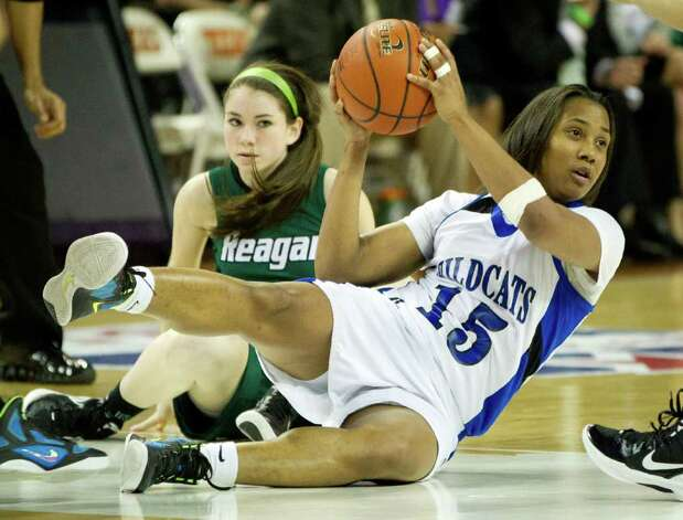 Spring Dekaney guard Alexis Durley (15) comes up with a loose ball in a scramble against San Antonio Reagan guard Bailey Champion during second half action in a class 5A semifinal game during the UIL girls state basketball tournament at the Frank Erwin Center on Friday, March 2, 2012, in Austin. Dekaney won the game 50-35. Photo: Smiley N. Pool, Houston Chronicle / © 2012  Houston Chronicle