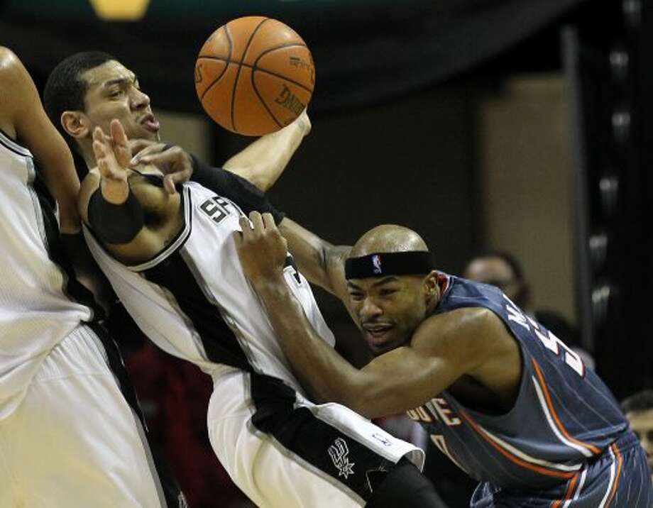 Spurs' Danny Green (04) defends against Charlotte Bobcats' Corey Maggette (50) in the first half at the AT&T Center on Friday, Mar. 2, 2012. Kin Man Hui/San Antonio Express-News (San Antonio Express-News)