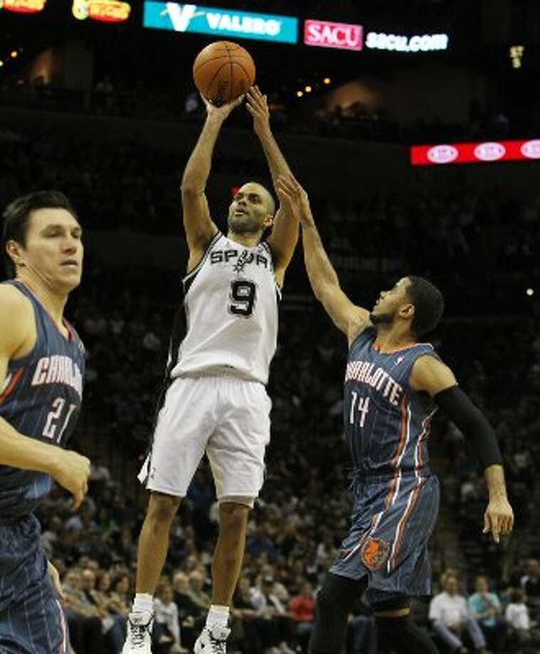Spurs' Tony Parker (09) shoots over Charlotte Bobcats' D.J. Augustin (14) in the second half at the AT&T Center on Friday, Mar. 2, 2012. Kin Man Hui/San Antonio Express-News (San Antonio Express-News)