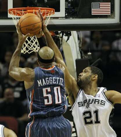 Spurs' Tim Duncan (21) attempts to block a shot against Charlotte Bobcats' Corey Maggette (50) in the second half at the AT&T Center on Friday, Mar. 2, 2012. Kin Man Hui/San Antonio Express-News (San Antonio Express-News)