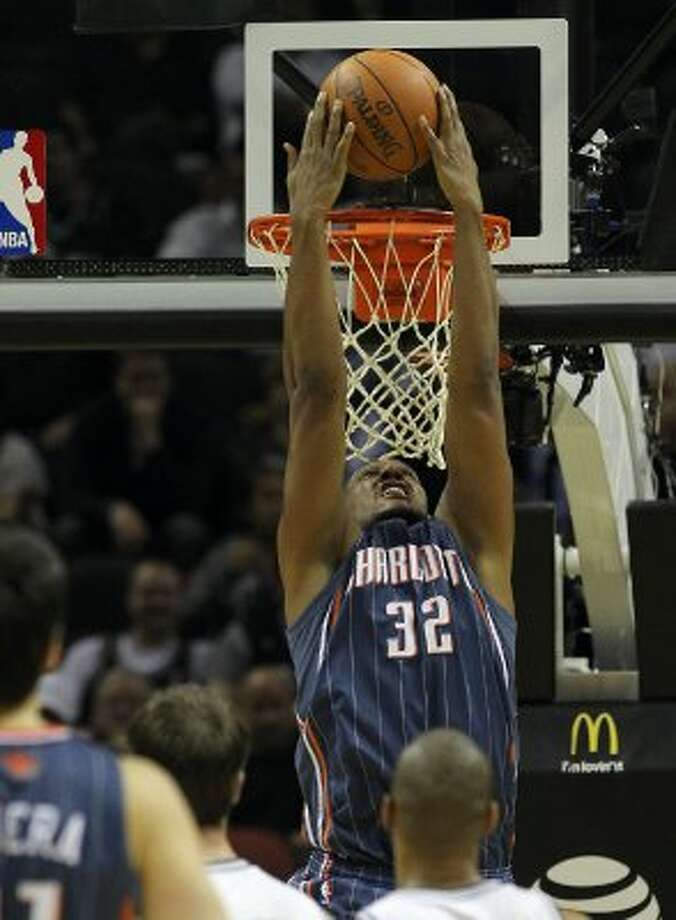 Charlotte Bobcats' Boris Diaw (32) gets an open dunk against the Spurs in the second half at the AT&T Center on Friday, Mar. 2, 2012. Kin Man Hui/San Antonio Express-News (San Antonio Express-News)