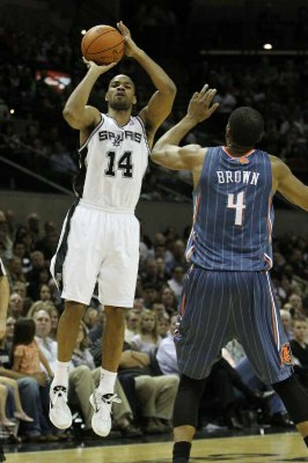 Spurs' Gary Neal (14) lines up a three-pointer against Charlotte Bobcats' Derrick Brown (04) in the second half at the AT&T Center on Friday, Mar. 2, 2012. Kin Man Hui/San Antonio Express-News (San Antonio Express-News)