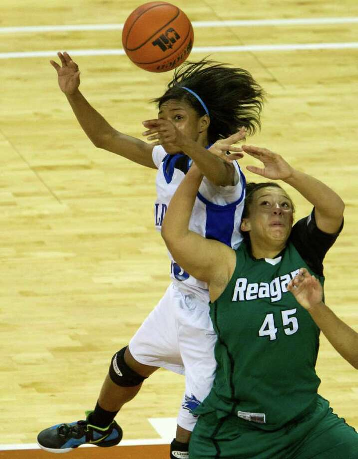 Spring Dekaney guard Jaleesa Chapel (25) knocks a ball away from San Antonio Reagan center Corrigan Tibbs (45) during second half action in a class 5A semifinal game during the UIL girls state basketball tournament at the Frank Erwin Center on Friday, March 2, 2012, in Austin. Dekaney won the game 50-35. Photo: Smiley N. Pool, Houston Chronicle / © 2012  Houston Chronicle