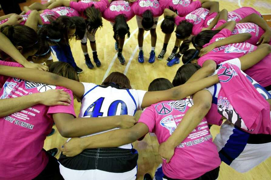 Spring Dekaney players huddle in prayer following their victory over San Antonio Reagan in a class 5