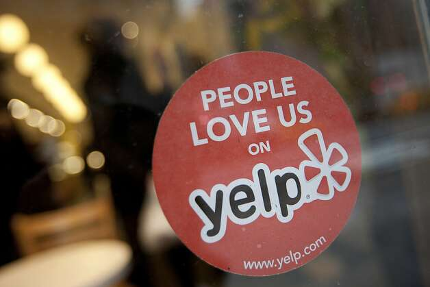 The Yelp Inc. logo is displayed in the window of a restaurant in New York, U.S., on Thursday, March 1, 2012. Yelp Inc., the site that lets users review everything from diners to dentists, is set to price it's IPO tonight and could potentially raise as much as $100 million, which would value the company at about $838 million. Photographer: Scott Eells/Bloomberg Photo: Scott Eells, Bloomberg