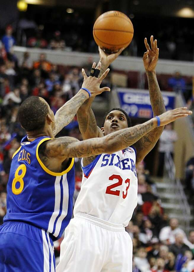 Golden State Warriors guard Monta Ellis (8) defends as Philadelphia 76ers guard Lou Williams (23) shoots in the second half of an NBA basketball game, Friday, March 2, 2012, in Philadelphia. Williams led all scorers with 25 points as the 76ers won 105-83. (AP Photo/Alex Brandon) Photo: Alex Brandon, Associated Press