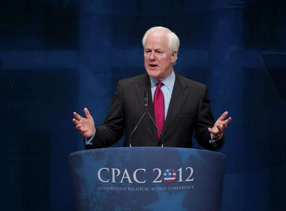 """Sen. John Cornyn, R-Texas, speaks last month. On Friday, he said policies from Washington are """"the biggest threat to our energy renaissance."""" Photo: J. Scott Applewhite / AP"""