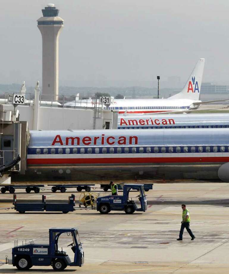 "Some years ago, American Airlines, whose biggest hub is in Dallas, tried offering ""more legroom in coach"" at no extra charge. Other airlines refused to follow. Photo: RON T. ENNIS / Fort Worth Star-Telegram"