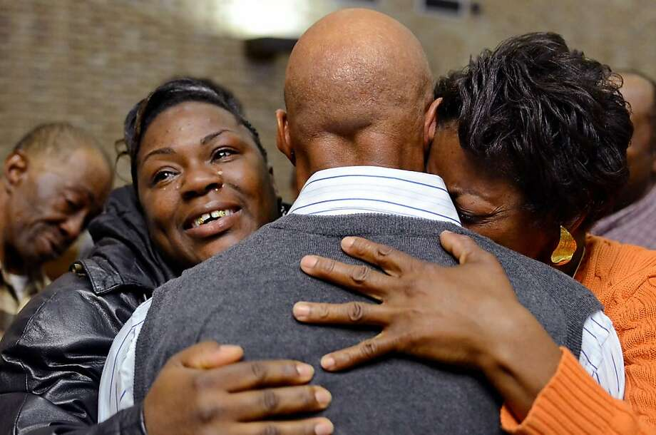 Family members hug Edward Lee Elmore after his hearing on Friday, March 2, 2012 in Greenwood, S.C.   Elmore, who spent 30 years in prison for murdering Dorothy Edwards, a crime that Elmore said he did not commit, was set free by Judge Frank Addy on Friday.  (AP Photo/ Richard Shiro) Photo: Richard Shiro, Associated Press