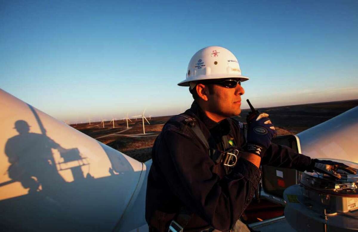 Manny Dominguez of BP's Sherbino 2 wind farm radios the office while working 285 feet in the air atop turbine 53 east of Fort Stockton. BP is beefing up its investments in wind energy and recently launched the wind farm near Fort Stockton, its fourth in Texas.