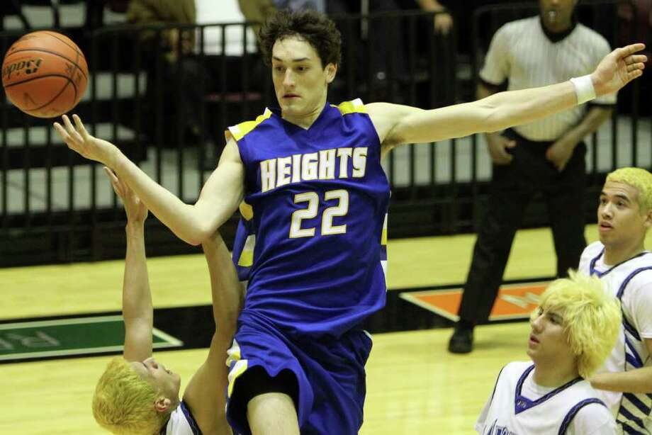 Heights' Jeffrey Rodewald goes for a jump shot late in the game. Alamo Heights beat Lanier 72-58 in the Region IV-4A semifinals at Littleton Gymnasium, Friday, March 2, 2012. (JENNIFER WHITNEY) Photo: JENNIFER WHITNEY, Express-News / special to the Express-News