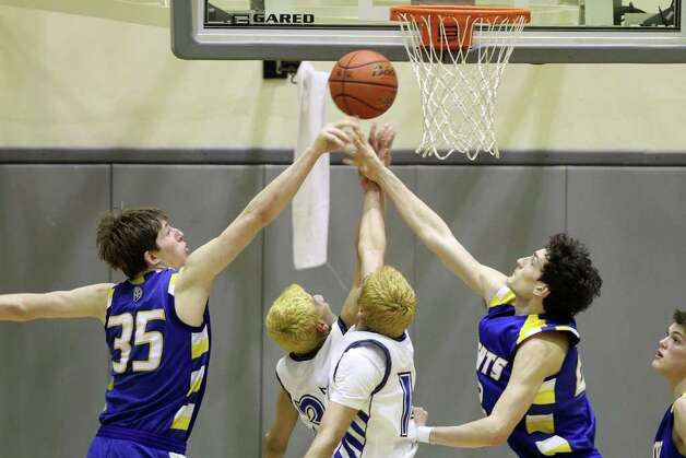 Heights'  Wes Miller and Jeffrey Rodewald get the rebound. Alamo Heights beat Lanier 72-58 in the Region IV-4A semifinals at Littleton Gymnasium, Friday, March 2, 2012. (JENNIFER WHITNEY) Photo: JENNIFER WHITNEY, Express-News / special to the Express-News