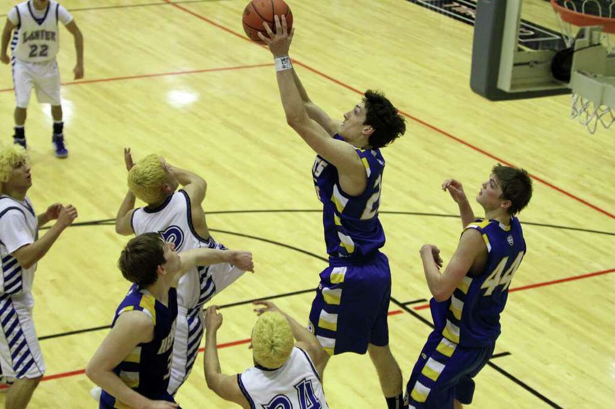 Heights' Jeffrey Rodewald gets the rebound in the second half. Alamo Heights beat Lanier 72-58 in the Region IV-4A semifinals at Littleton Gymnasium, Friday, March 2, 2012. (JENNIFER WHITNEY)