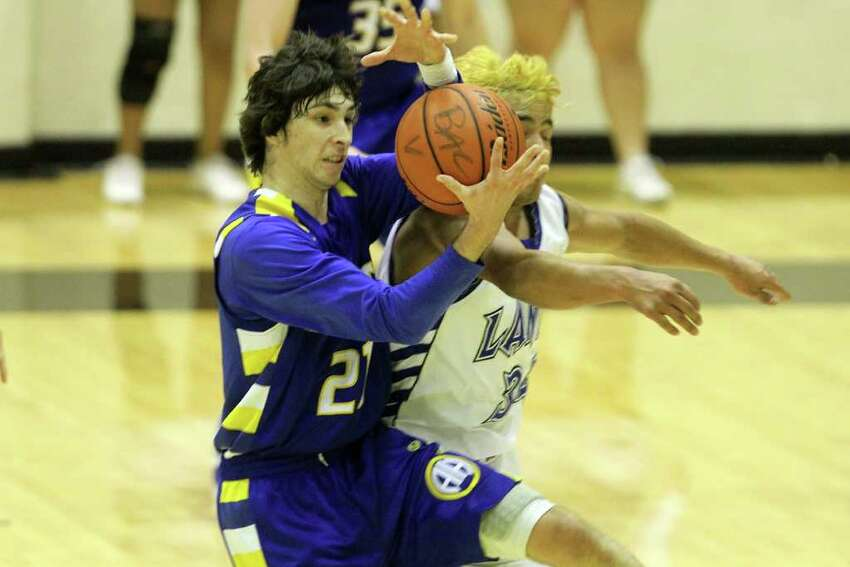 Alamo Heights' Dylan Lieck holds on to the rebound. Alamo Heights beat Lanier 72-58 in the Region IV-4A semifinals at Littleton Gymnasium, Friday, March 2, 2012. (JENNIFER WHITNEY)