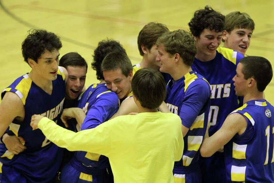 Alamo Heights celebrates after they beat Lanier 72-58 in the Region IV-4A semifinals at Littleton Gymnasium, Friday, March 2, 2012. (JENNIFER WHITNEY) Photo: JENNIFER WHITNEY, Express-News / special to the Express-News