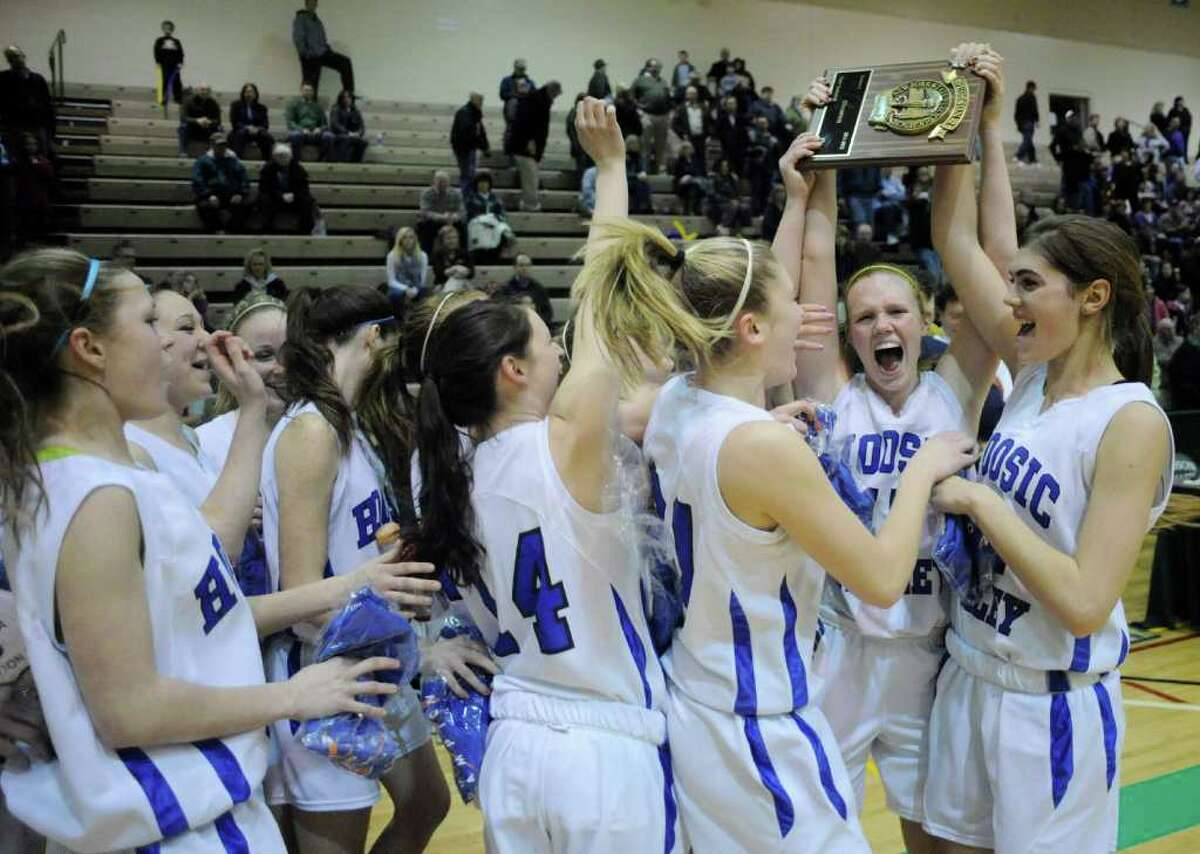 Hoosic Valley celebrates a 32-28 win over Voorheesville after their Section II Class C championship basketball game in Troy, N.Y., Friday, March 2, 2012. (Hans Pennink / Special to the Times Union) High School Sports