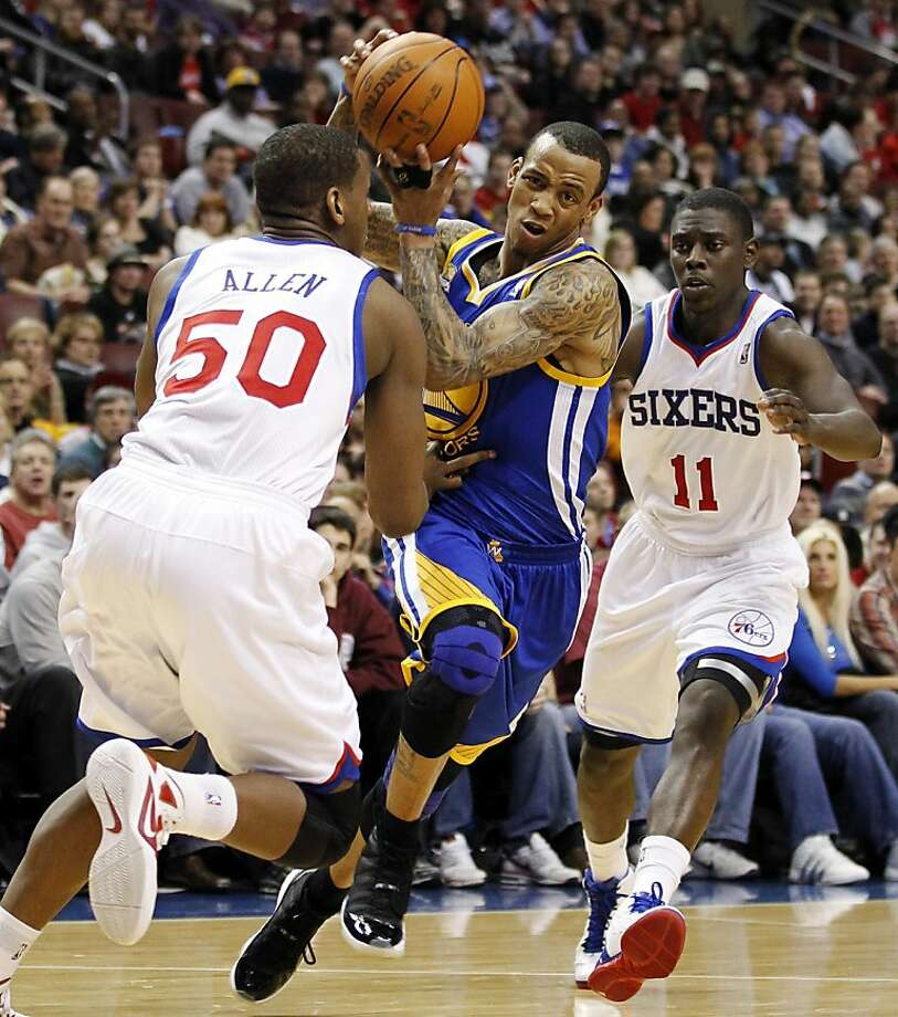 Philadelphia 76ers forward Lavoy Allen (50) and guard Jrue Holiday (11) pressure Golden State Warriors guard Monta Ellis (8) in the first half of an NBA basketball game, Friday, March 2, 2012, in Philadelphia. Photo: Alex Brandon, Associated Press