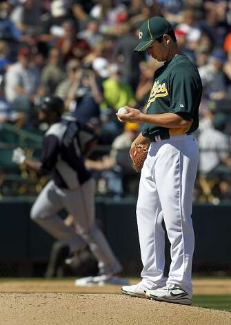 Oakland reliever Tommy Milone gave up a two-run homer to Seattle's Carlos Peguero as the A's lose to the Mariners 8-5 in the Cactus League spring training opener at Phoenix, Ariz. on Friday, March 2, 2012. Photo: Paul Chinn, The Chronicle