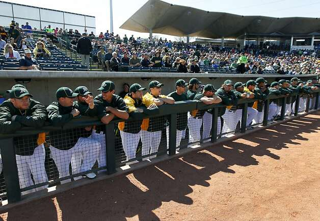 Oakland players wait for the start of the A's Cactus League spring training opener against the Seattle Mariners in Phoenix, Ariz. on Friday, March 2, 2012. Photo: Paul Chinn, The Chronicle
