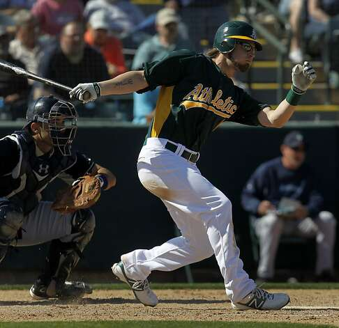 Right fielder Josh Reddick bats in the Oakland A's Cactus League spring training opener against the Seattle Mariners in Phoenix, Ariz. on Friday, March 2, 2012. Photo: Paul Chinn, The Chronicle