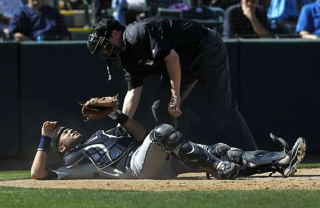 Seattle catcher Jesus Montero left the game after taking a beating behind the plate in the Oakland A's Cactus League spring training opener against the Mariners in Phoenix, Ariz. on Friday, March 2, 2012. Photo: Paul Chinn, The Chronicle