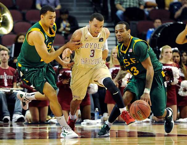 Anthony Ireland #3 of the Loyola Marymount Lions starts a fast break between Cole Dickerson #25 and Rashad Green #13 of the San Francisco Dons during a quarterfinal game of the Zappos.com West Coast Conference Basketball tournament at the Orleans Arena March 2, 2012 in Las Vegas, Nevada. Photo: Ethan Miller, Getty Images