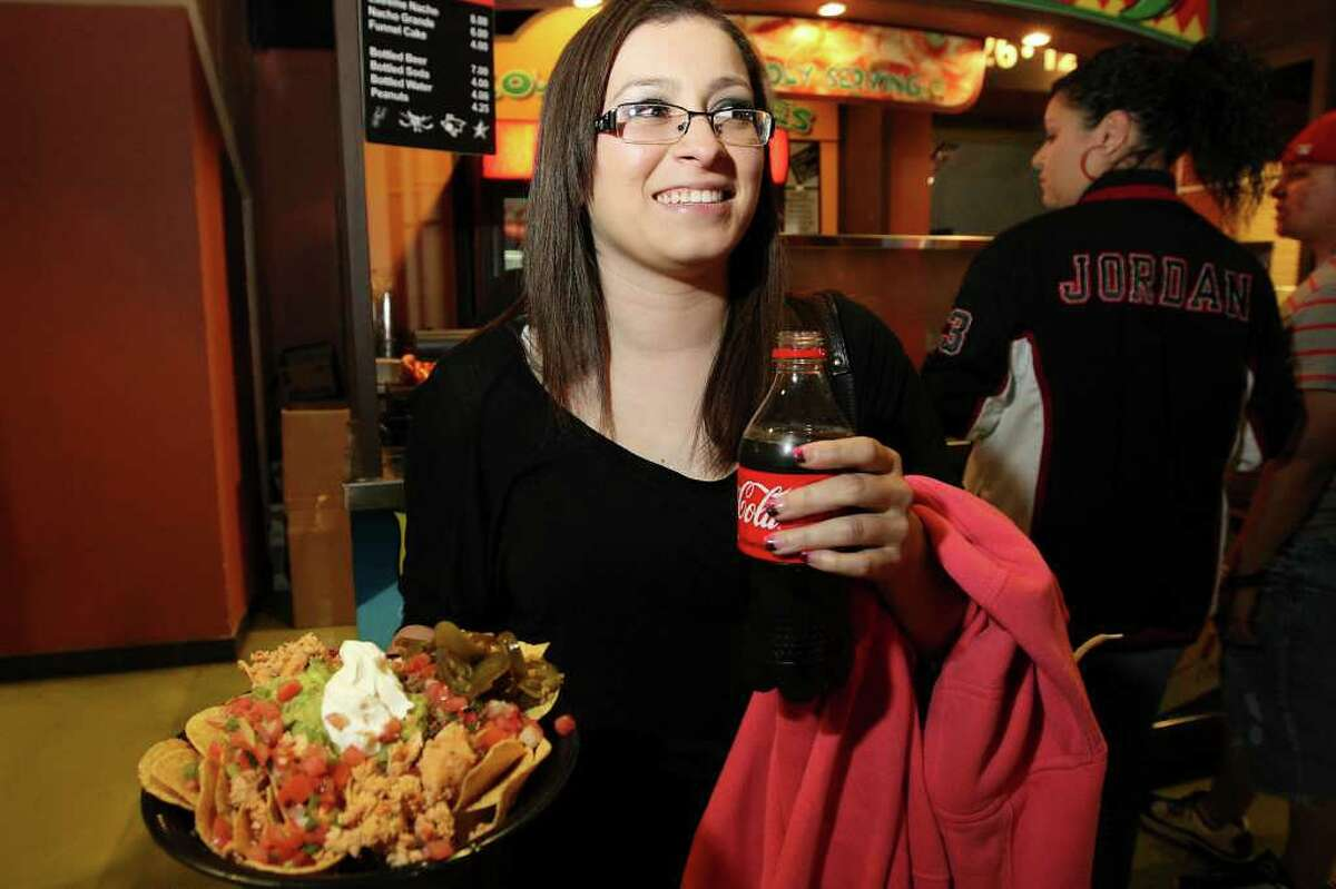 Cassandra Duarte buys Extreme Nachos made with Ricos Products at the AT&T Center during the San Antonio Spurs game, Wednesday, Feb. 29, 2012.
