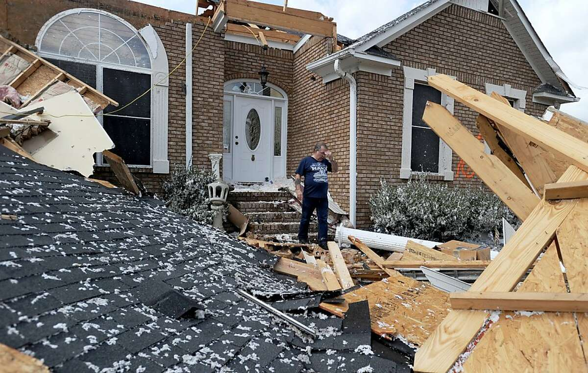 Charles Kellogg walks away from his destroyed house after severe weather hit the Eagle Point subdivision in Limestone County, Ala. on Friday, March 2, 2012. A reported tornado destroyed several houses in northern Alabama as storms threatened more twisters across the region Friday (AP Photo/The Decatur Daily, Jeronimo Nisa)
