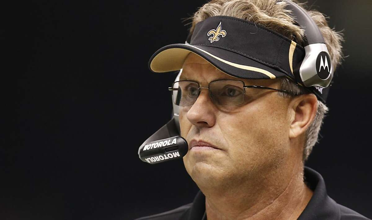 FILE - In this Sept. 26, 2010, file photo, Saints defensive coordinator Gregg Williams looks on during an NFL football game against the Atlanta Falcons at the Louisiana Superdome in New Orleans. Williams, the former Saints defensive coordinator, apologized for running a bounty program that targeted opposing players for injuries. In a statement, he says the program was a