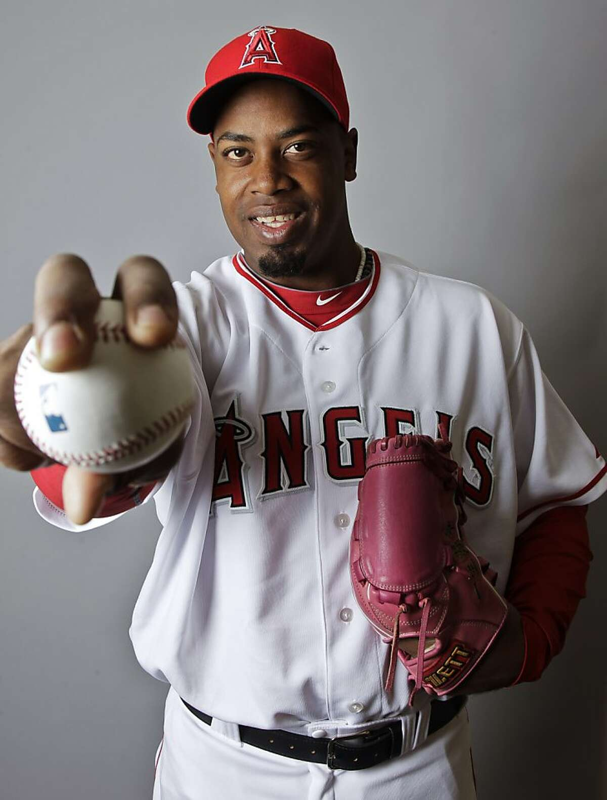 Los Angeles Angels' Jerome Williams holds a baseball during the team's photo day before a spring training baseball workout Wednesday, Feb. 29, 2012, in Tempe, Ariz. (AP Photo/Morry Gash)
