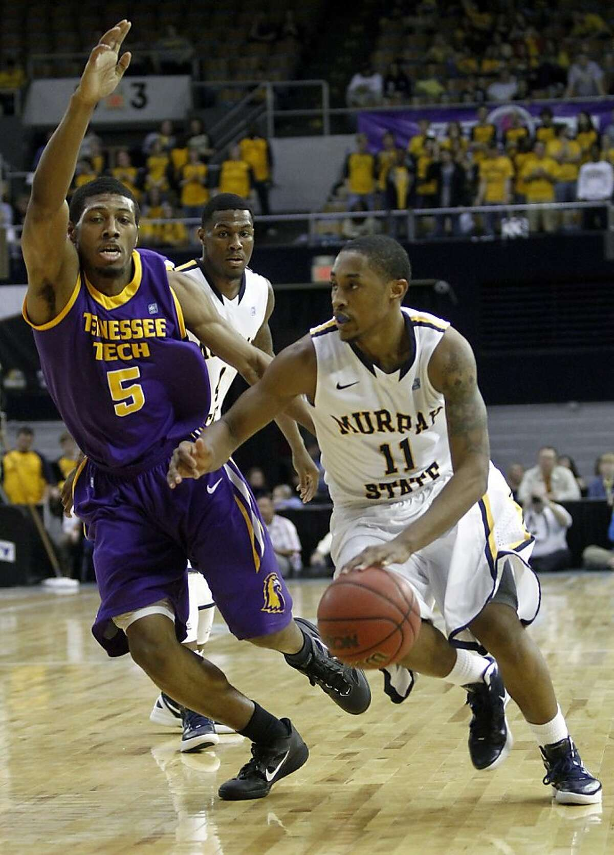 Murray State's Donte Poole (11) drives against Tennessee Tech's Javon McKay (5) in the second half of an NCAA college basketball game at the Ohio Valley Conference tournament on Friday, March 2, 2012, in Nashville, Tenn. Murray State won 78-58. (AP Photo/Wade Payne)