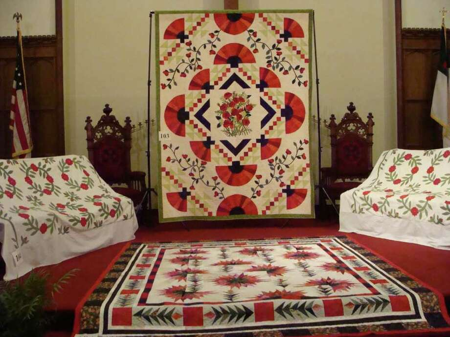 """Quilts on display Friday in the sanctuary of Southport Congregational Church for the annual ìA Quilt Exhibit: Fabrics & Fabrications"""" exhibit. Photo: Meg Barone / Fairfield Citizen freelance"""
