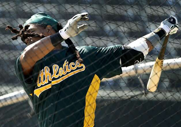 Hair flies in his face as Manny Ramirez takes batting practice before the Oakland A's Cactus League spring training opener against the Seattle Mariners in Phoenix, Ariz. on Friday, March 2, 2012. Photo: Paul Chinn, The Chronicle