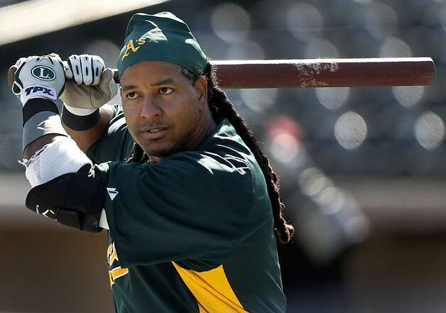 Manny Ramirez works with batting coach Chili Davis before the Oakland A's Cactus League spring training opener against the Seattle Mariners in Phoenix, Ariz. on Friday, March 2, 2012. Photo: Paul Chinn, The Chronicle