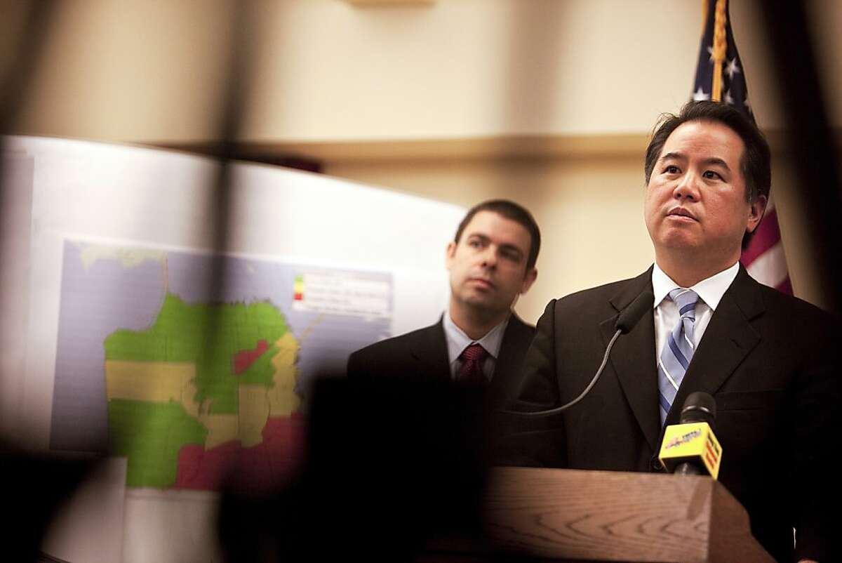 Phil Ting, the San Francisco assessor-recorder, right, and Lou Pizante of Aequitas, during a news conference in San Francisco, Feb. 15, 2012. They announced that an audit by San Francisco officials, which was commissioned by Ting, of about 400 recent foreclosures there determined that almost all involved either legal violations or suspicious documentation, according to a report released Wednesday. (Annie Tritt/The New York Times)