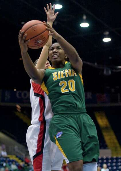 Siena's Kanika Cummings (20), drives to the basket as Fairfield's Brittany MacFarlane, behind, defen