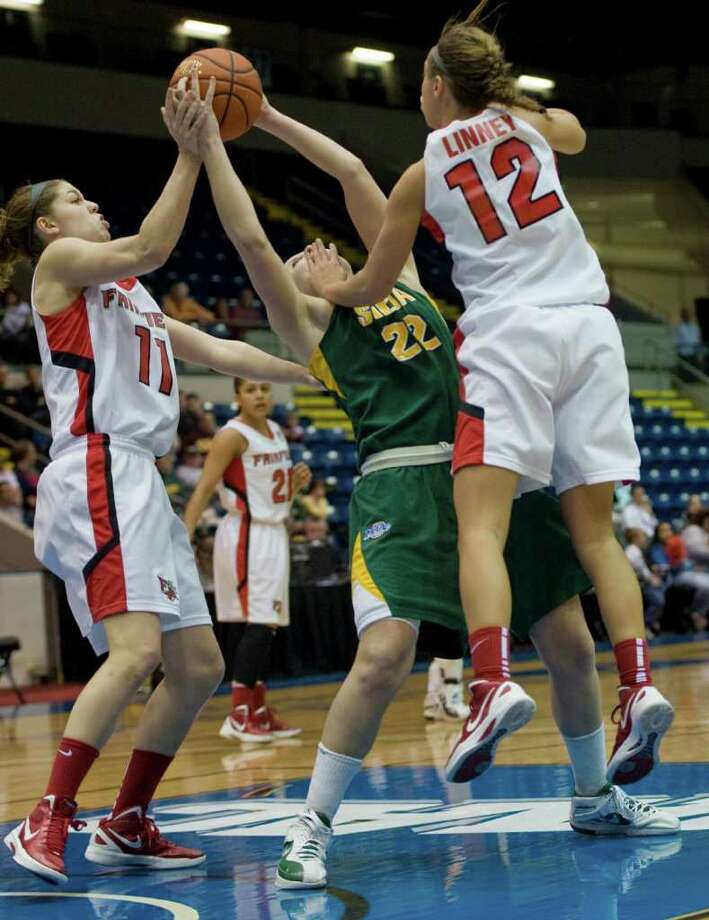 Fairfield's Brittany MacFarlane, left, and Katelyn Linney, right, pressure Siena's Lily Grenci, center, in the second half of a MAAC women's semifinal college basketball game in Springfield, Mass., Saturday, March 3, 2012. Siena lost to Fairfield 63-48. (Jessica Hill / Special to the Times Union) Photo: Jessica Hill